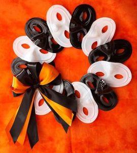 Orange and black masks make a Halloween wreath
