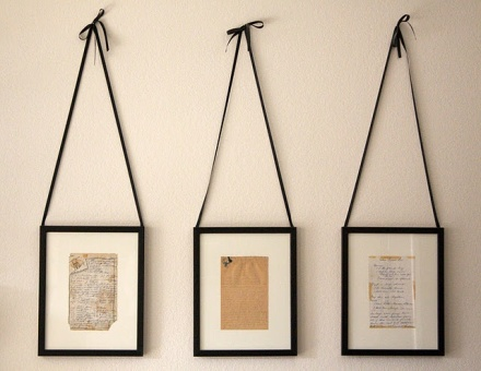 Scan Grandma's hand-written recipe cards, use thrift shop frames... and hang from black satin ribbons to show them for the gifts from your past that they are!