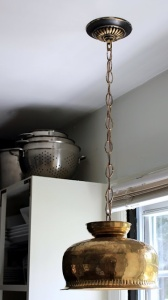 A consignment shop brass bowl makes a terrific hanging lamp, says HowToConsign.com